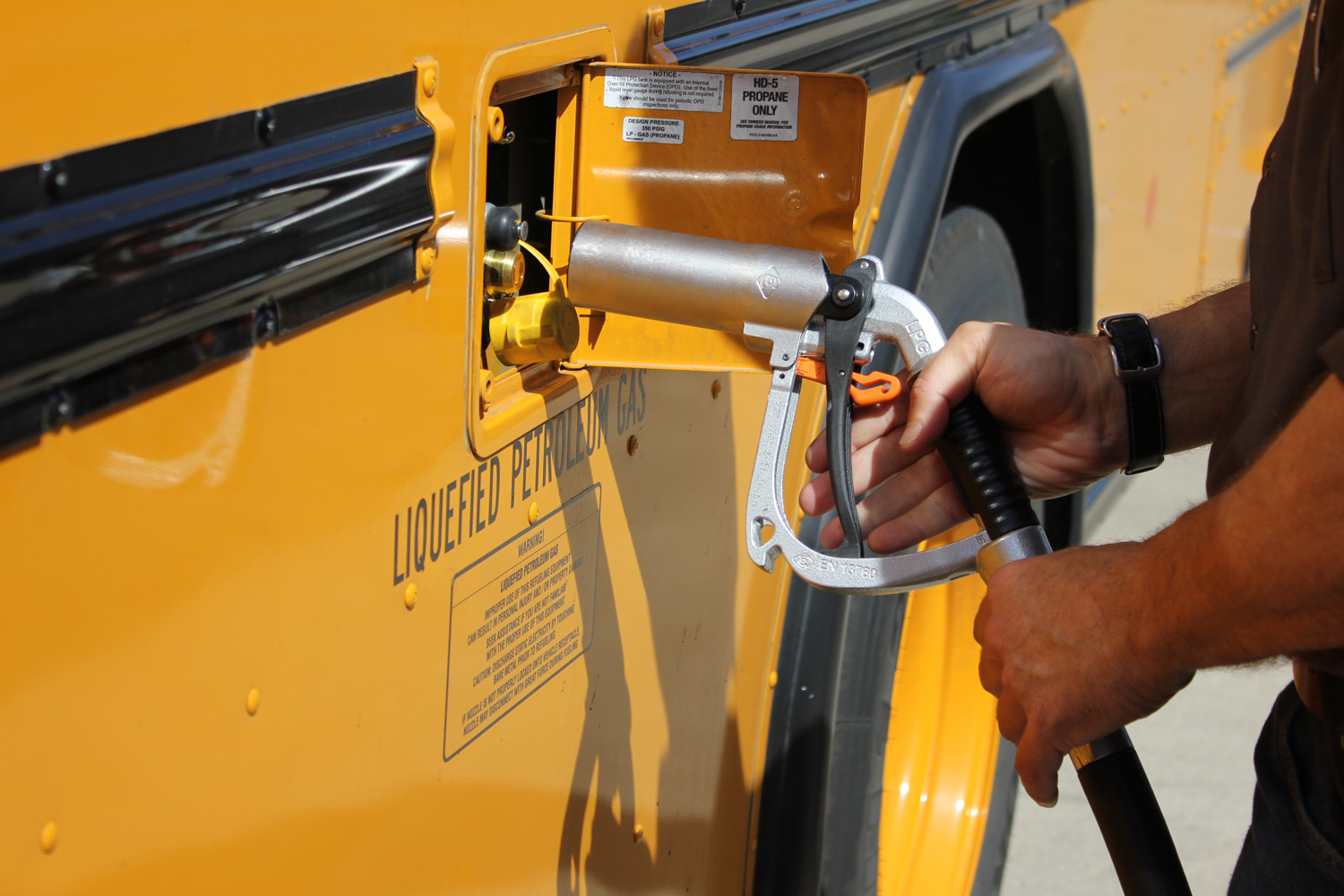An image of a person filling a bus.